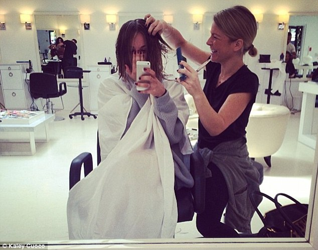 Work in progress: The Big Bang theory star posted a picture of her sitting in stylist Christine Symonds' chair while she was having her hair cut