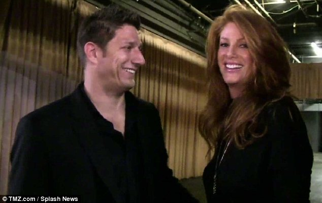 Just engaged!: Angie Everhart's boyfriend popped the question on Tuesday night... and she said yes