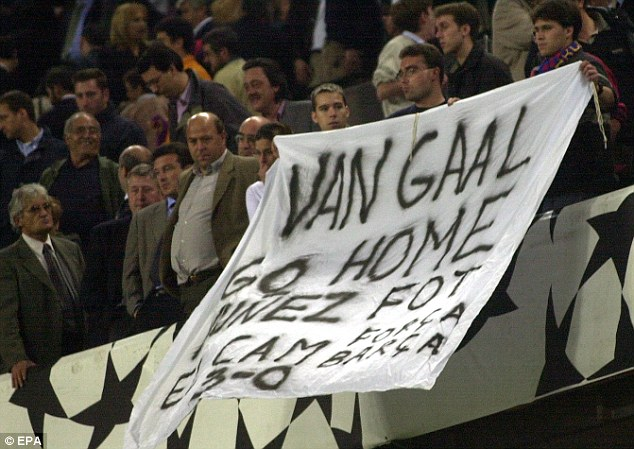 Spelling it out: Barcelona supporters ask for the resignation of Van Gaal and then preisdent Josep Lluis Nunez in 2000