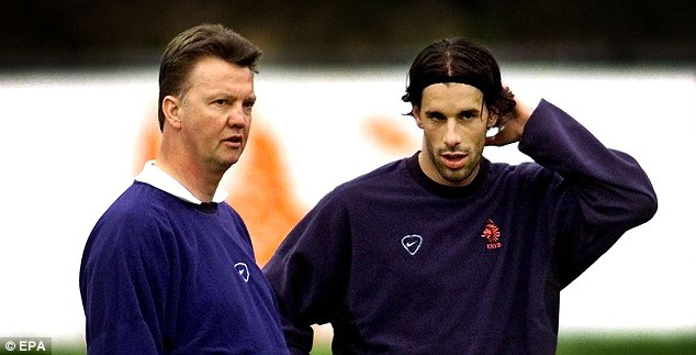Protective: Van Gaal and Ruud van Nistelrooy chew the fat in a Dutch training session