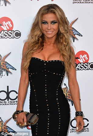 Split: Carmen Electra and clothing mogul Tal Cooperman have broken up after a brief romance