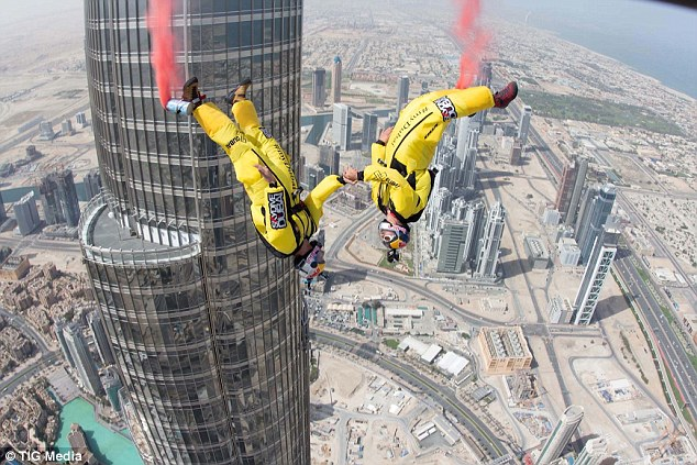 Heartstopping: Daredevil skydivers red Fugen and Vince Reffet set a new base jump world record by leaping 2,717 feet from Dubai's Burj Khalifa tower - the tallest building in the world