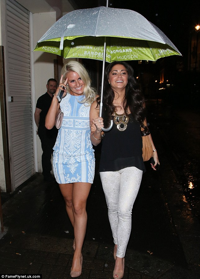 Under your umbrella: Danielle and Casey were happy to share an umbrella to keep them dry as they left Chotto Matte in London on Wednesday night