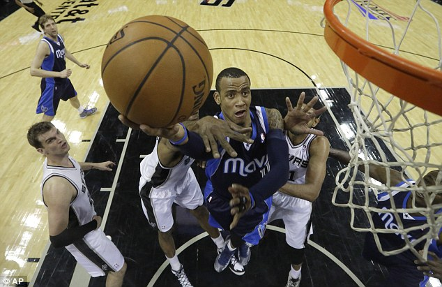 Driving on: Monta Ellis helped Dallas cruise past San Antonio and level their series at 1-1