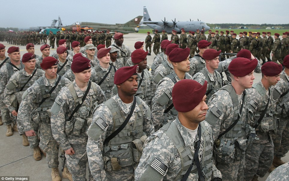 Formation: Members of the 173rd Airborne Brigade march past a Polish paratrooper unit after a ceremony upon the U.S. troops' arrival