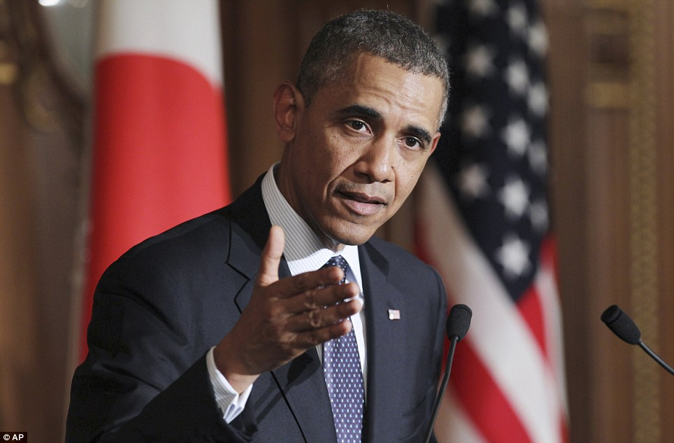 Warning to Russia: President Barack Obama speaking at a joint press conference with Japanese Prime Minister Shinzo Abe at the Akasaka State Guest House in Tokyo on Thursday