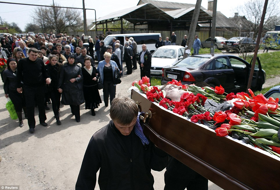 The coffin of Donetsk deputy Volodymyr Rybak is carried during his funeral in the village of Horlivka, in eastern Ukraine. The Ukrainian town councillor was apparently kidnapped and tortured by pro-Russians