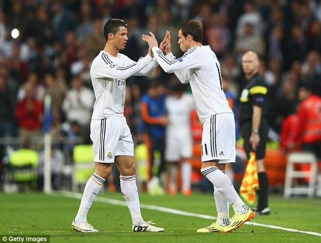 Time for change: Gareth Bale replaces Ronaldo with 16 minutes remaining at the Bernabeu