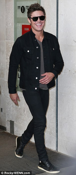 Like a rock star: The actor wore black jeans with a jacket and dark sunglasses