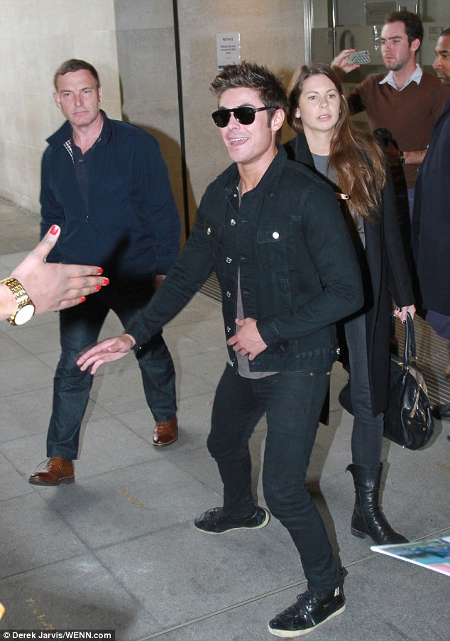 High five: Following the interview Zac looked in good spirits