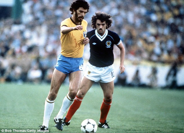 In awe: Rodgers loved the style of play of the 1982 Brazil team, with Socrates battling Scotland's John Wark