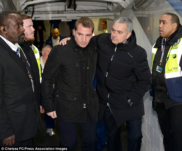 Reunited: Brendan Rodgers and Jose Mourinho embrace when Liverpool met Chelsea in December