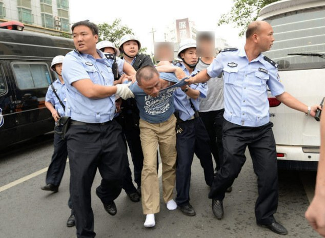 Taken in: Police arrested Wu over the callous murder of mah-jong bar owner Mr Chang