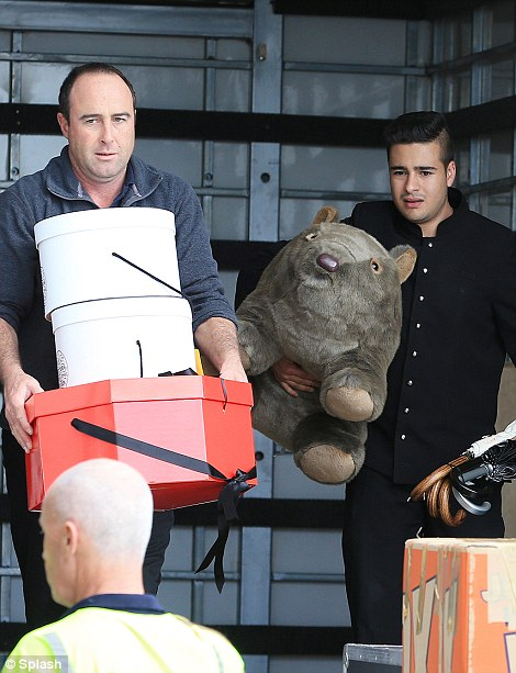Royals depart Sydney along with all their Gifts today, seen carried by porters