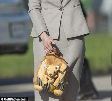 George's nanny Maria Teresa Turrion Borrallo clutching the kangaroo backpack the little Prince was given by a fan when they briefly touched down in Sydney