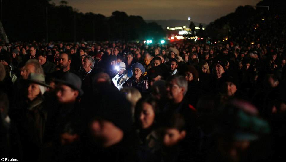 Thousands attend a dawn memorial service on ANZAC Day at the Australian National War Memorial in Canberra April 25, 2014
