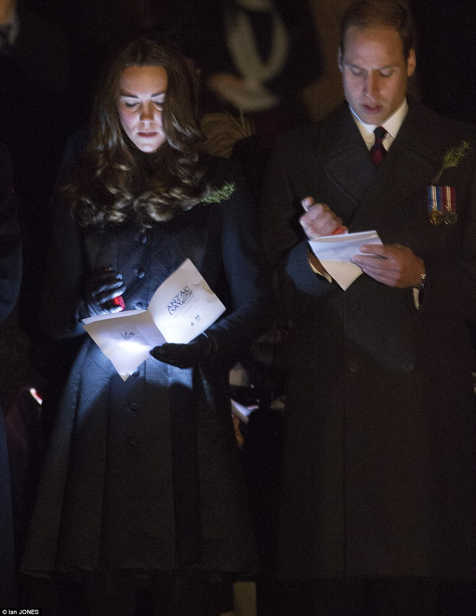 Kate and William read the order of service by torchlight at 5.30am on Anzac Day