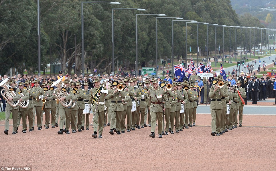 Honoured: The Anzac Day march in Canberra at the Australian War Memorial featured the honour guard and band who were applauded