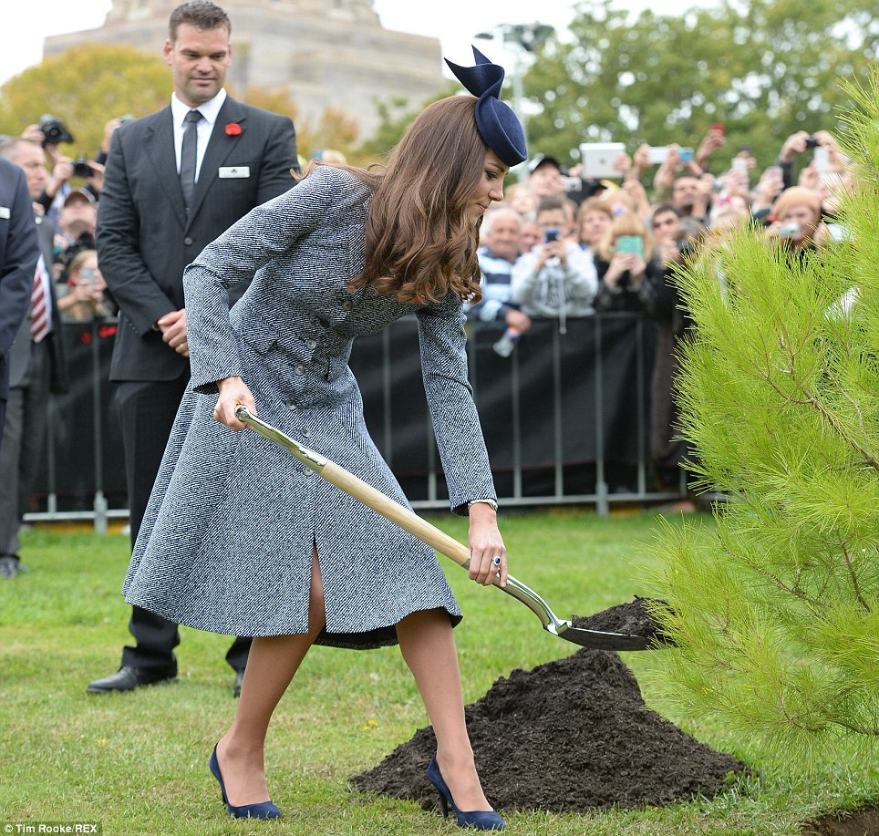 Watched: The crowd eagerly took photos of the Duchess as she shoveled mud in Australia's capital