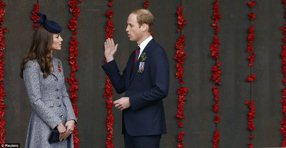 Private moment: The Duke and Duchess are pictured talking by the poppy lined World War I Wall of Remembrance at the Australian National War Memorial
