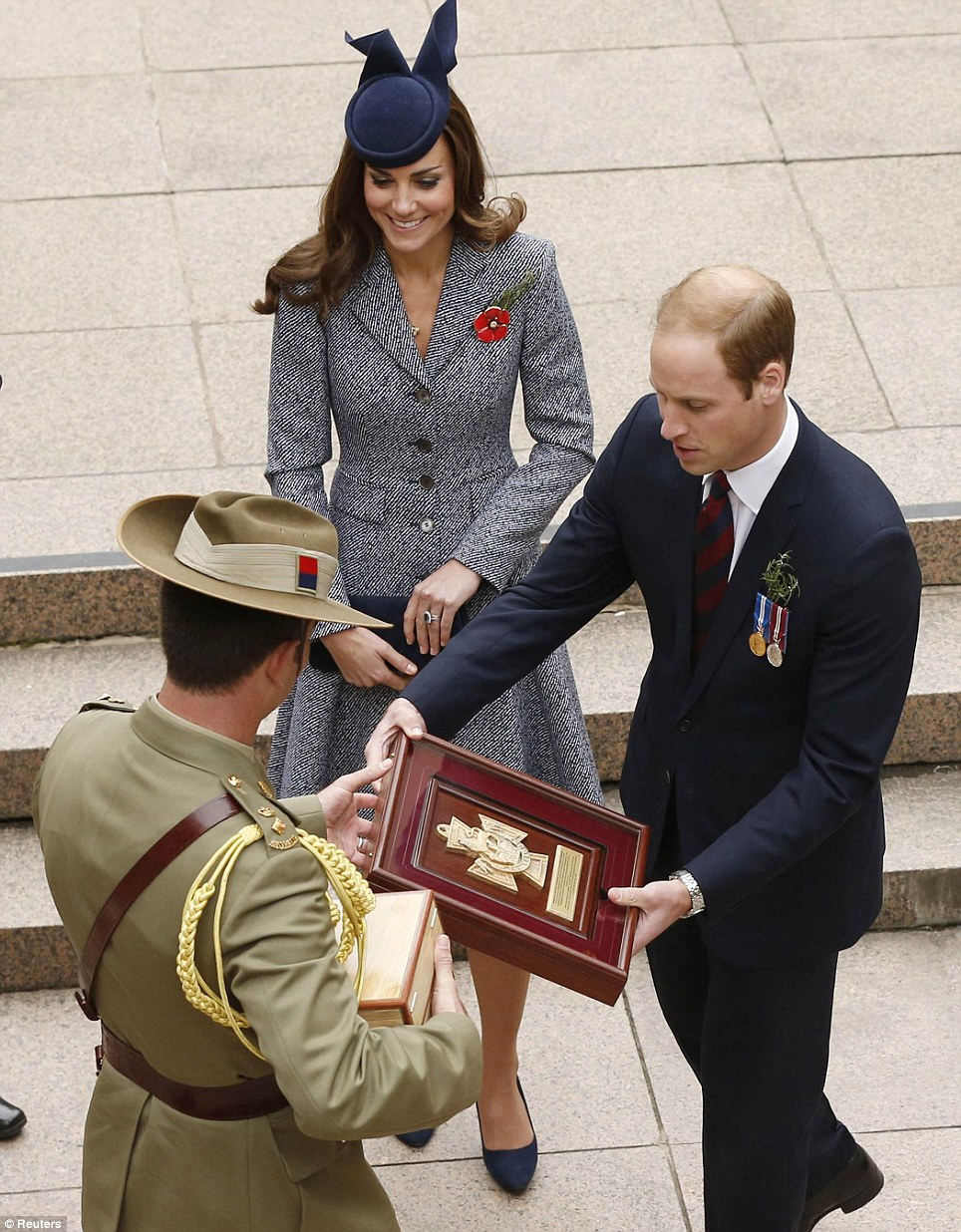 Gift: William was given a photograph of Prince Henry's tree planting, framed in wood from the war memorial's lone pine