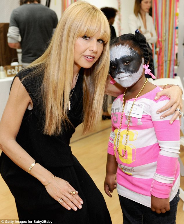 Cute as a button: The celebrities mingled with children at the event while the tots enjoyed the activities