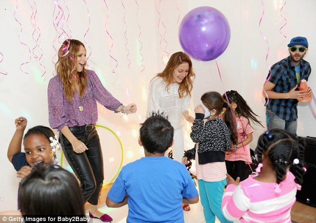 Party time: Actress Sasha Alexander was dancing with Molly while surrounded by colourful balloons