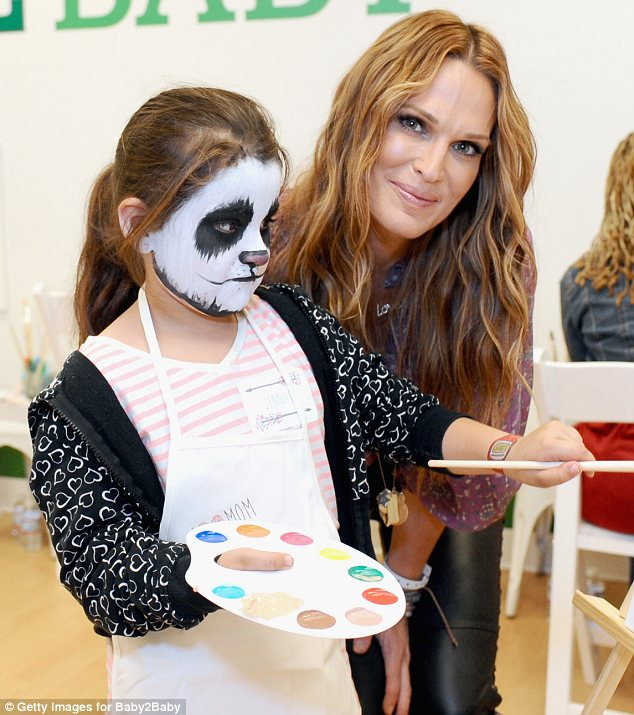 Proud to be involved: Molly, who has a 22-month-old son, spent time with a young girl and aspiring artist