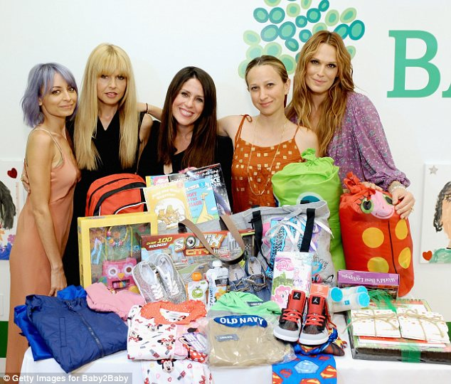 Say cheese: Nicole, Rachel, Soleil, jewellery designer Jen Meyer and Molly posed with gifts for the charity, which supplies Los Angeles families with essential baby gear and clothing for children