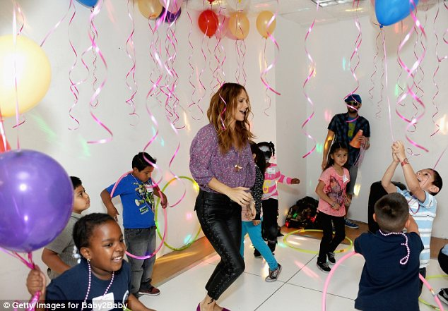 Dancing queen: Molly Sims spent much of her time pulling shapes on the dance floor with the children