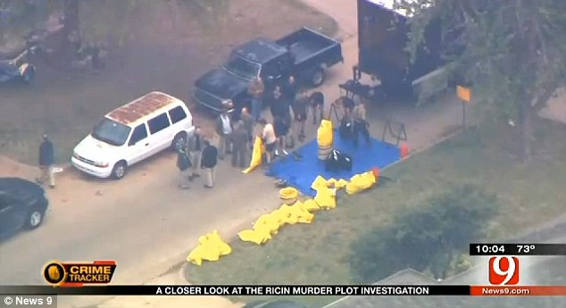 Raid: Rhoads' home was searched last week by agents in hazmat suits