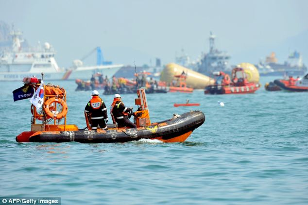 Rescue team personnel take part in recovery operations at the site of the sunken South Korean ferry 'Sewol'