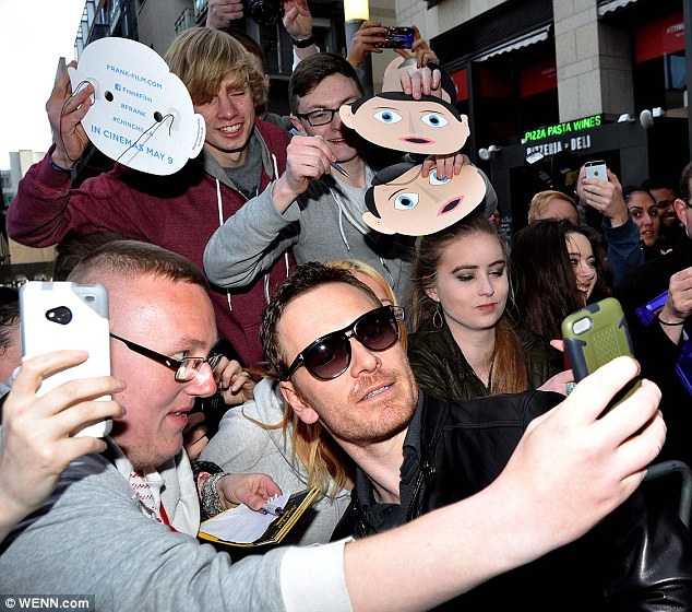 Tribute: The star's fans were carrying the iconic Frank masks as they met him on the red carpet