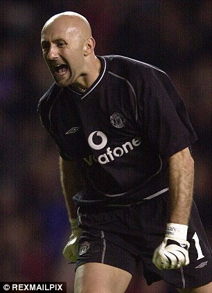Between the sticks: Barthez celebrates while playing for Manchester United