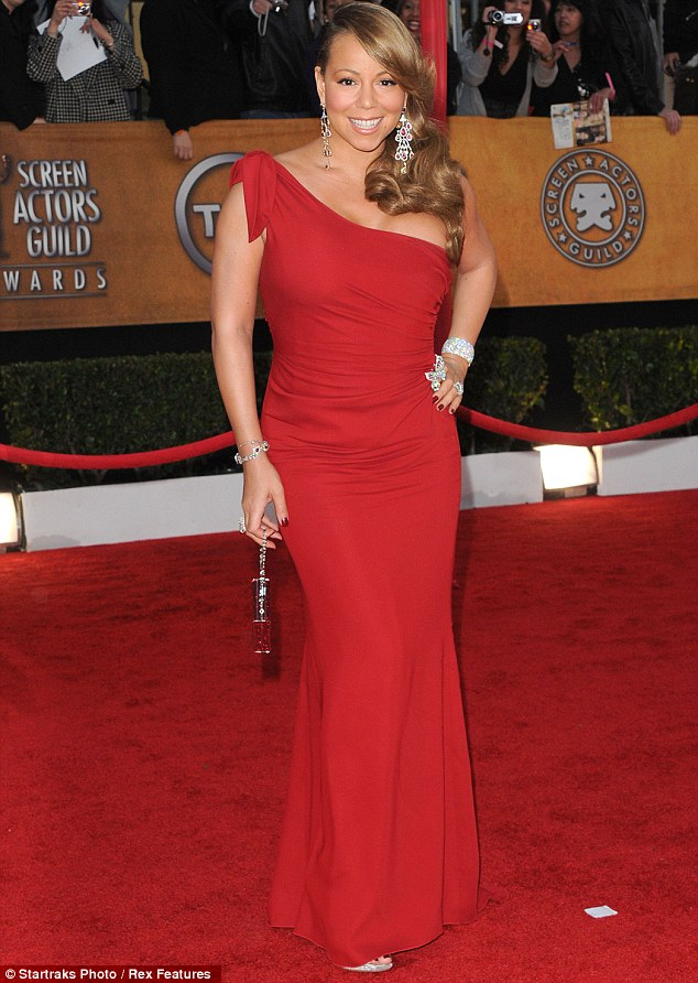 Long timing coming: Mariah started working on her album in 2010, pictured here in Jan that year at SAG Awards