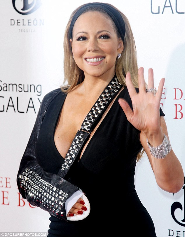 Played it down: Mariah will share more about her shoulder injury last week