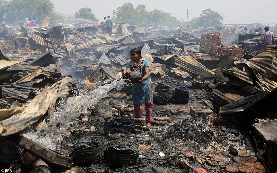 Fire: The cause of the fire is not yet known, but it seems likely to have been started either by someone cooking on charcoal in one of the cramped alleyways, or by electrical short circuit from the many thousands of illegal power connections (seen in the distance)