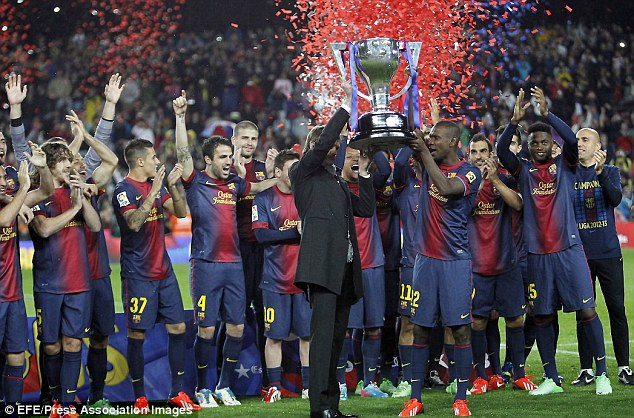 Winner: Vilanova (left) and Eric Abidal (right) lift the La Liga trophy together in 2013