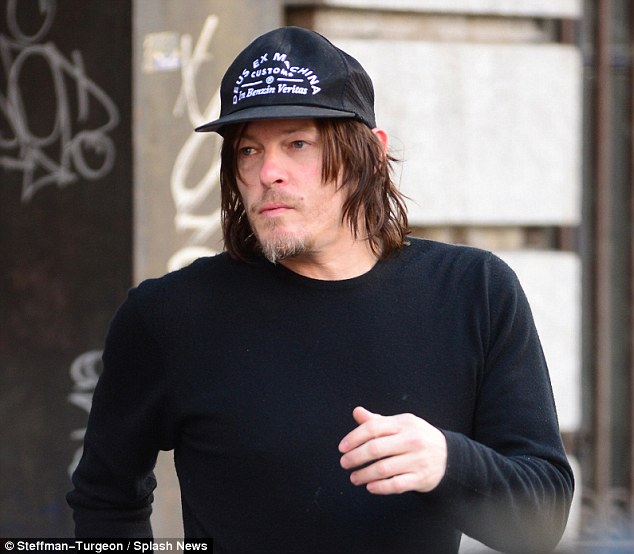 Benzin Veritas: Norman has been seen wearing this hat, which translates to 'God from the machine' and 'motor fuel truth', on numerous occasions