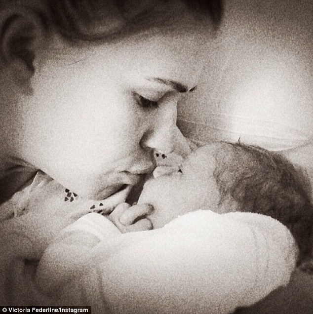 Proud mom: Posting a picture of her self kissing her newborn, Victoria Prince wrote, 'No words can describe a moment like this'