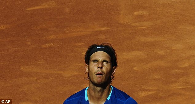 Downbeat: Rafael Nadal suffered another shock defeat against Nicolas Almagro in Barcelona