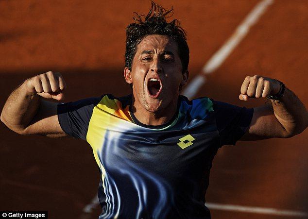 Delight: Nicolas Almagro celebrates beating fellow-Spaniard Rafael Nadal in Barcelona