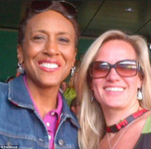 Best friends: Robin has described her girlfriend Amber Laign (right) as the 'wind beneath my wings' - and has revealed that throughout their decade-long relationship, the couple have lived separately