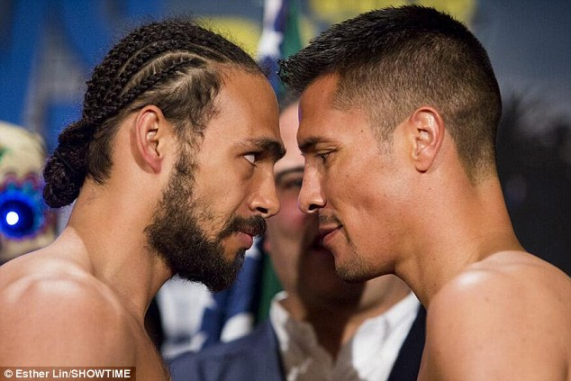 Face to face: Keith Thurman (left) squares up to Julio Diaz ahead of their fight on Saturday