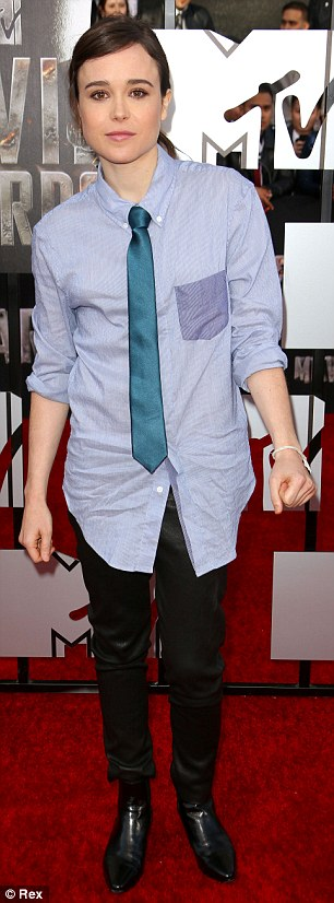 Polished: Ellen looking sleek in a dress shirt, tie, and trousers at the MTV Movie Awards