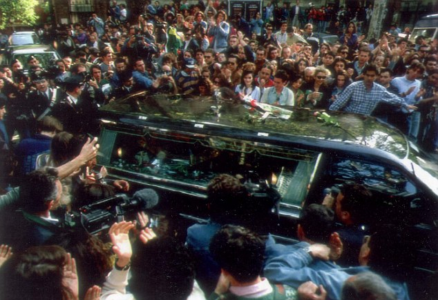 Loved: Senna's hearse is surrounded by fans after his body was transported from a hospital in Bologna