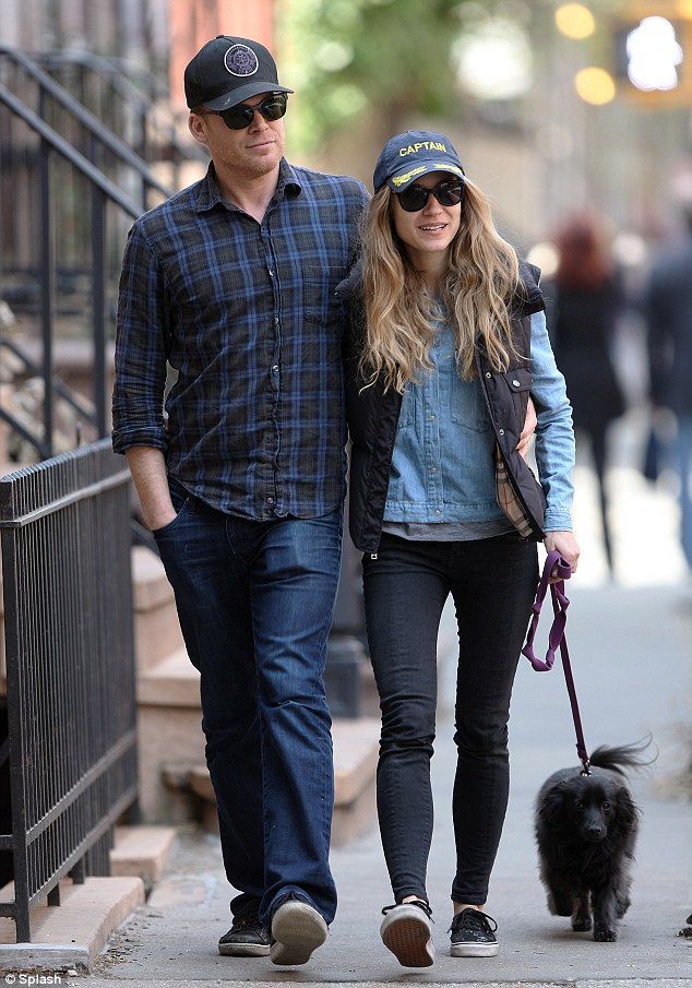 Holding her tightly: The 43-year-old actor wrapped his arm around girlfriend Morgan as they took his dog for a walk