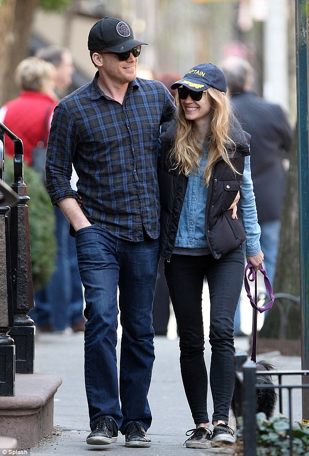 Cute couple: Michael C. Hall and his girlfriend Morgan Macgregor take a stroll around New York's West Village on Friday
