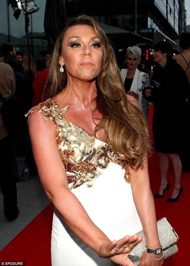 Tanned: Michelle sported a Grecian-style dress for the VIP Style Awards - but the look didn't last