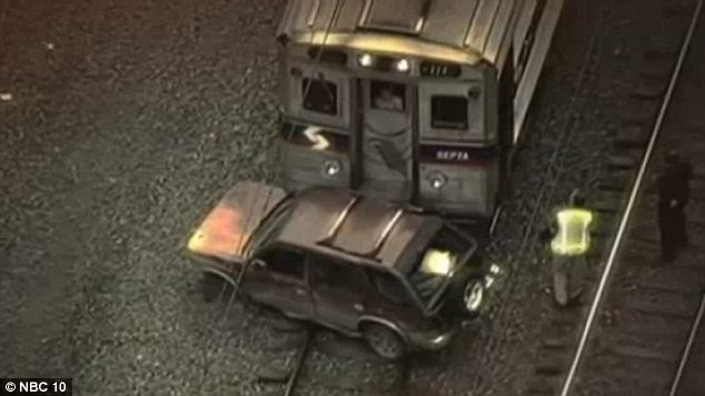 Police are still trying to find the people responsible for getting this SUV stuck on the tracks in the path of a SEPTA passenger train